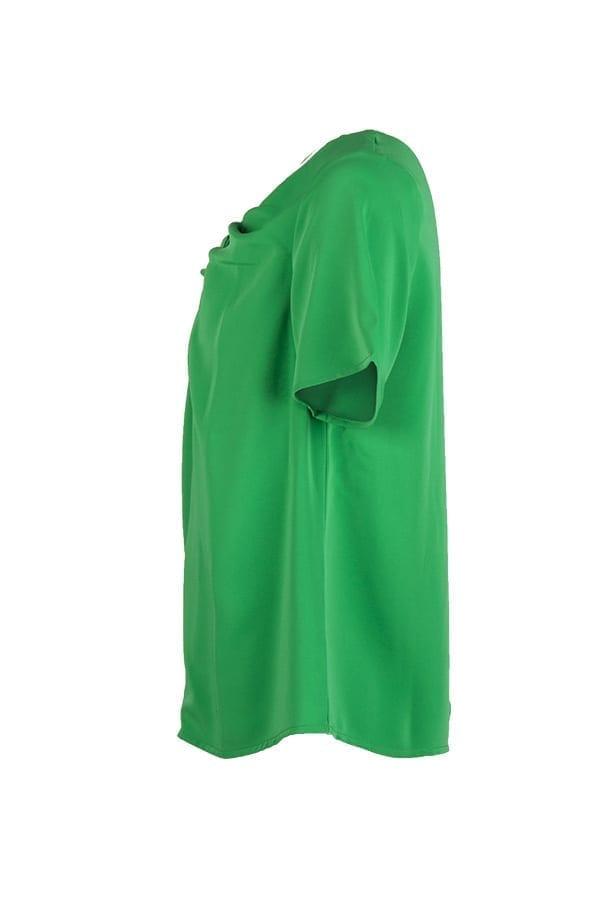 Kriss topp Doris i grönt med tvinnad detalj fram